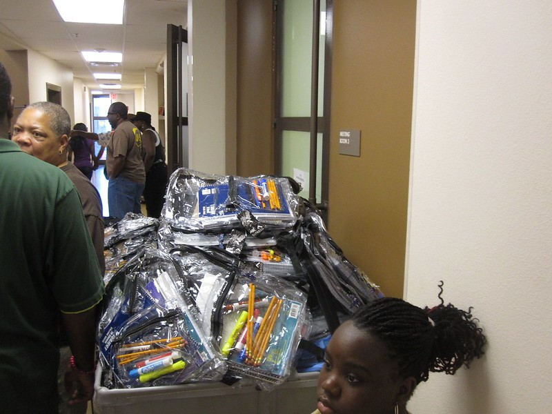 Volunteers packed supplies into hundreds of backpacks especially prepared by grade level.