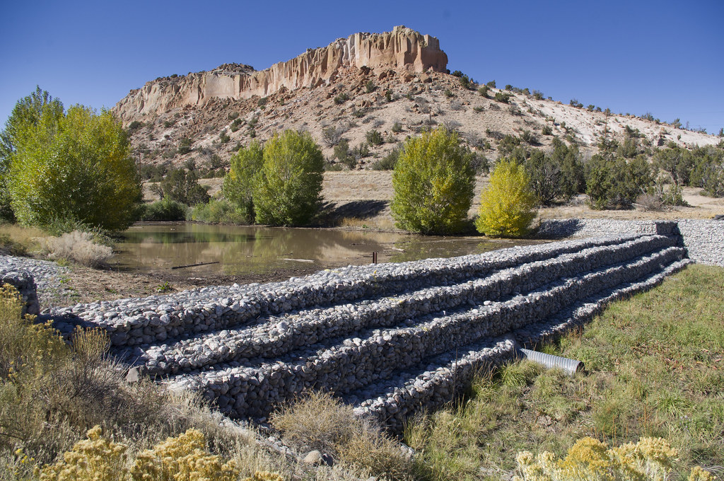 Sediment behind LA Canyon weir is sampled and excavated regularly. As of 2012, no sediment required disposal as hazardous or radioactive waste.