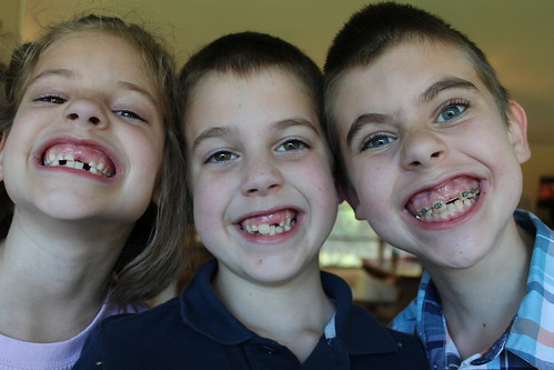 All three big kids with the same missing top left tooth :)