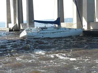 The Coast Guard is responding after receiving reports that a 38-foot sailboat struck the Buckman Bridge in Jacksonville, Fla., Thursday, Nov. 14, 2013. The sailboat, named Interceptor, broke free from its mooring at Mulberry Cove Marina in Jacksonville before the vessel struck a bridge fender and the mast struck the concrete beneath the roadway. (Photo courtesy of Mike Senft)