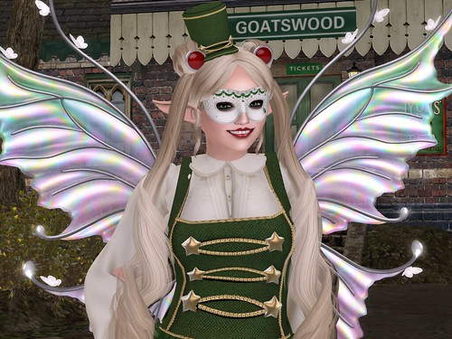 Deoridhe, dressed as above, standing in front of the Goatswood Train station and smiling.