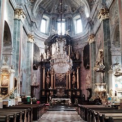 The interior of the Johns' church in Lublin. Beautiful chandeliers, frescos made by a famous 18th century painter (that create an illusion of the church's greater size than in reality), the ebony altar built from the Lebanese pear wood, famous paintings....