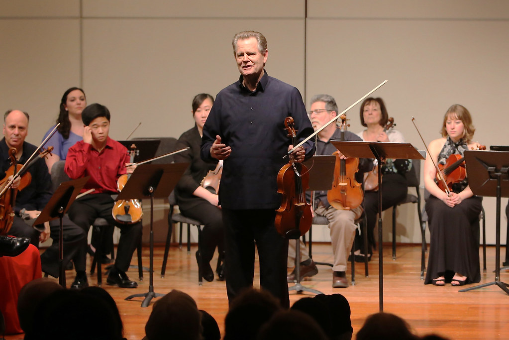Paul Yarbrough, Artistic Director, speaks to the audience of the Yehudi Menuhin Chamber Music Seminar and Festival Sunday, Feb. 16, 2014 in Knuth Hall. Photo by Ryan Leibrich / Xpress
