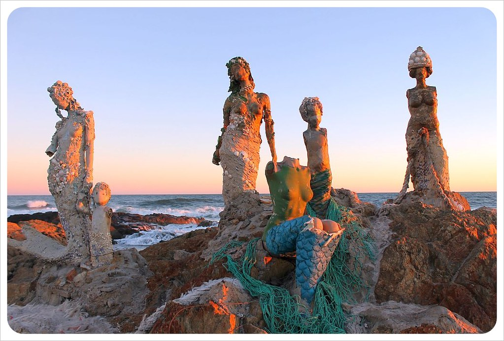 mermaid statues at sunset punta del este
