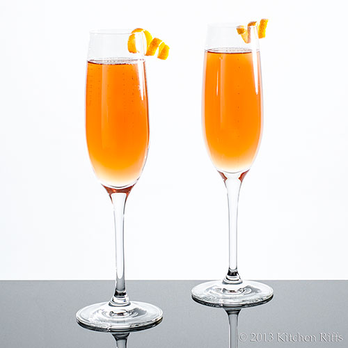 Seelbach Cocktails with Lemon Garnishes in Champagne Flutes