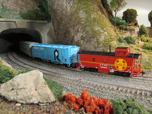 A 1970's era Santa Fe freight train enters the tunnel. by Eddie from Chicago