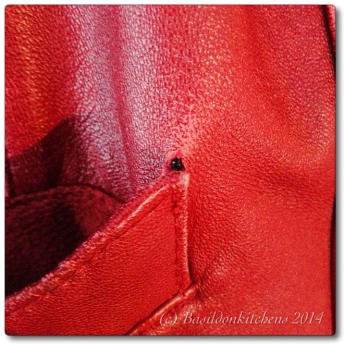 12/3/2014 - repair {my favourite red leather jacket is in need of a repair; the frequent use of the pocket is causing stress tear in the leather} #photoaday #repair #titlefx #red #leather #jacket #ouch