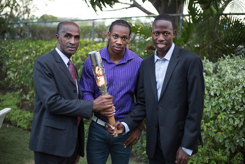 Legendary Jamaican sprinters Don Quarrie, Yohan Blake and future star Javon Francis hold the Queen's Baton in Kingston, Jamaica, Saturday 5 April 2014. Jamaica is nation 54 of 70 nations and territories the Queen's Baton will visit.