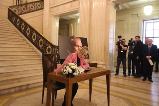 Michelle O'Neill signs the Book of Condolence to Martin McGuinness