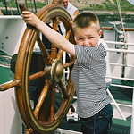 Cameron at the helm