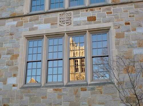 Gasson bell tower reflected in Fulton Hall
