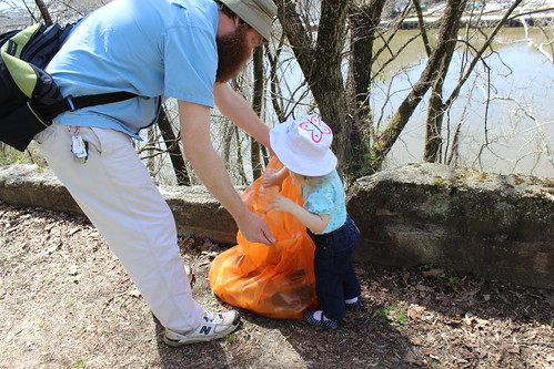 Friends of the Occoquan River Cleanup - Adela Throws Away Trash