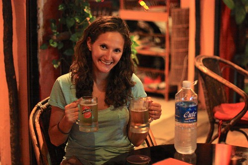 a cute girl, enjoying that 50 cent draft beer we talked about, with a cute water