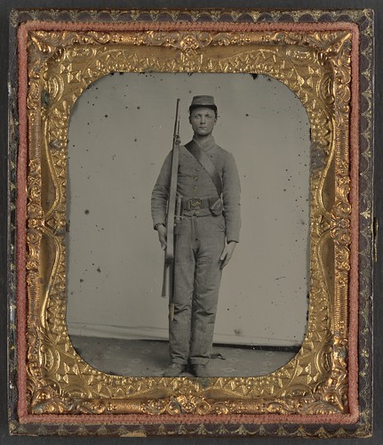 [Unidentified soldier in Confederate uniform and snake belt buckle with Enfield rifle and saber bayonet]  (LOC)