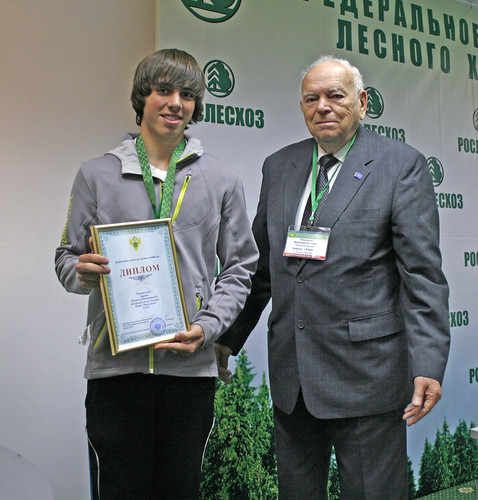 Tyler Myers of Lake Tahoe, Calif., is presented with his award at the International Jr. Foresters' Competition in Moscow in 2012. Tyler was teamed with Emily Barnett.  (Photo courtesy of Tyler Myers)