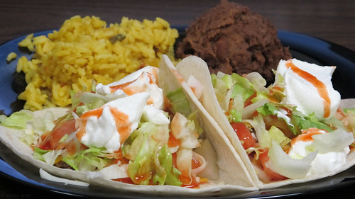 Soft tacos with Spanish rice and refried beans by Coyoty