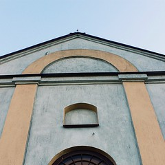 The façade of the chapel. A simple building that had some color added in the last few years. It used to be a grey and morbid looking building when I was a child....