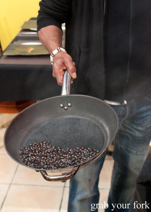 roasting Ethiopian coffee beans Jambo Jambo Ethiopian African Restaurant Crows Nest