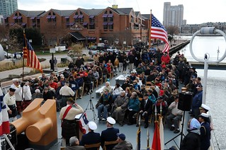 A crowd of more than 150 people pay their respects to the sacrifices made by veterans during a memorial held aboard the Coast Guard Cutter Taney in Baltimore marking the 72nd anniversary of the attack on Pearl Harbor, Hawaii, December 7, 2013. The Taney is the last United States vessel still afloat that had been involved with the attack on Pearl Harbor, Hawaii. U.S. Coast Guard photo by Petty Officer 3rd Class Matthew S. Masaschi