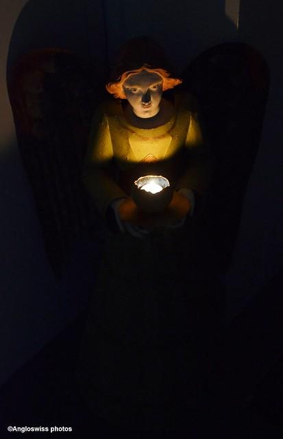 illuminated angel at the door