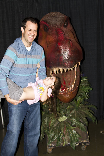 feeding her to the dinosaur