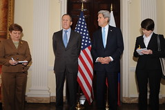 Flanked by a pair of translators, Russian Foreign Minister Sergey Lavrov addresses reporters before a meeting with U.S. Secretary of State John Kerry at Winfield House, the U.S. Ambassador's Residence in London, United Kingdom, on March 14, 2014. [State Department photo/ Public Domain]
