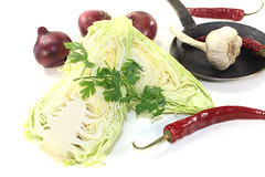 sweetheart cabbage with onions in a pan