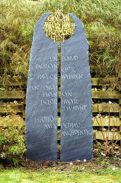 Quotation. Riven Welsh slate with brass filigree lettering