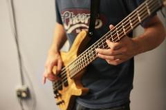 slide guitar(0.0), acoustic guitar(0.0), bassist(1.0), string instrument(1.0), musician(1.0), music(1.0), guitarist(1.0), guitar(1.0), jazz guitarist(1.0), bass guitar(1.0), string instrument(1.0),