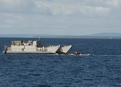 A U.S. Navy landing craft utility (LCU) prepares to move people and equipment ashore in Tonga from USS Pearl Harbor (LSD 52), June 12. (U.S. Navy photo by Mass Communication Specialist 2nd Class Tim D. Godbee)