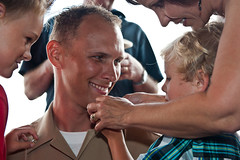 Chief Intelligence Specialist Joshua Mathias, assigned to the U.S. Pacific Command Joint Intelligence Operation Center, receives his chief petty officer anchors from his family, Sept. 13.  (U.S. Navy photo by Mass Communication Specialist 3rd Class Brennan D. Knaresboro)