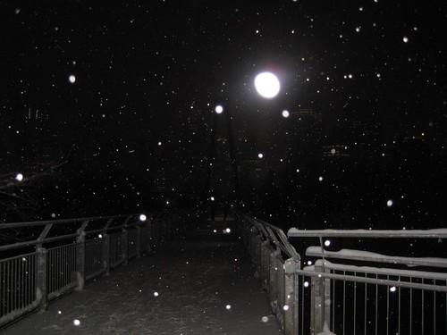 Night descends over the bridge.