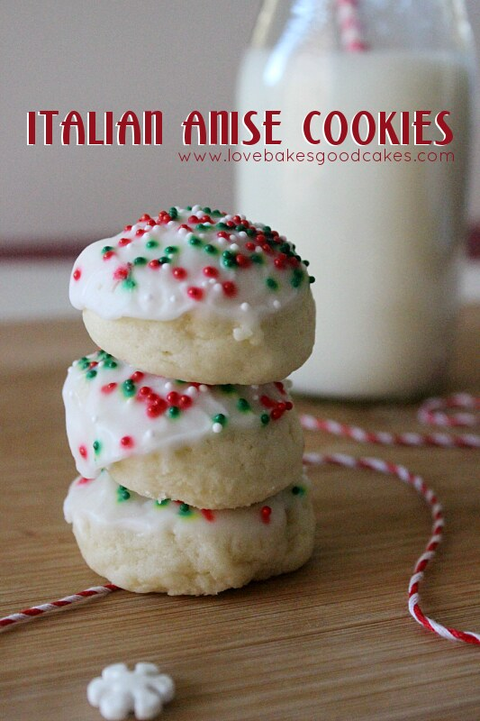 Italian Anise Cookies stacked on top of each other with a glass of milk.