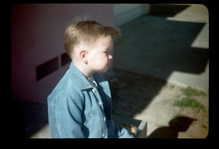 1946... A small boy puts up with siting still for the slow Kodachrome of those days.