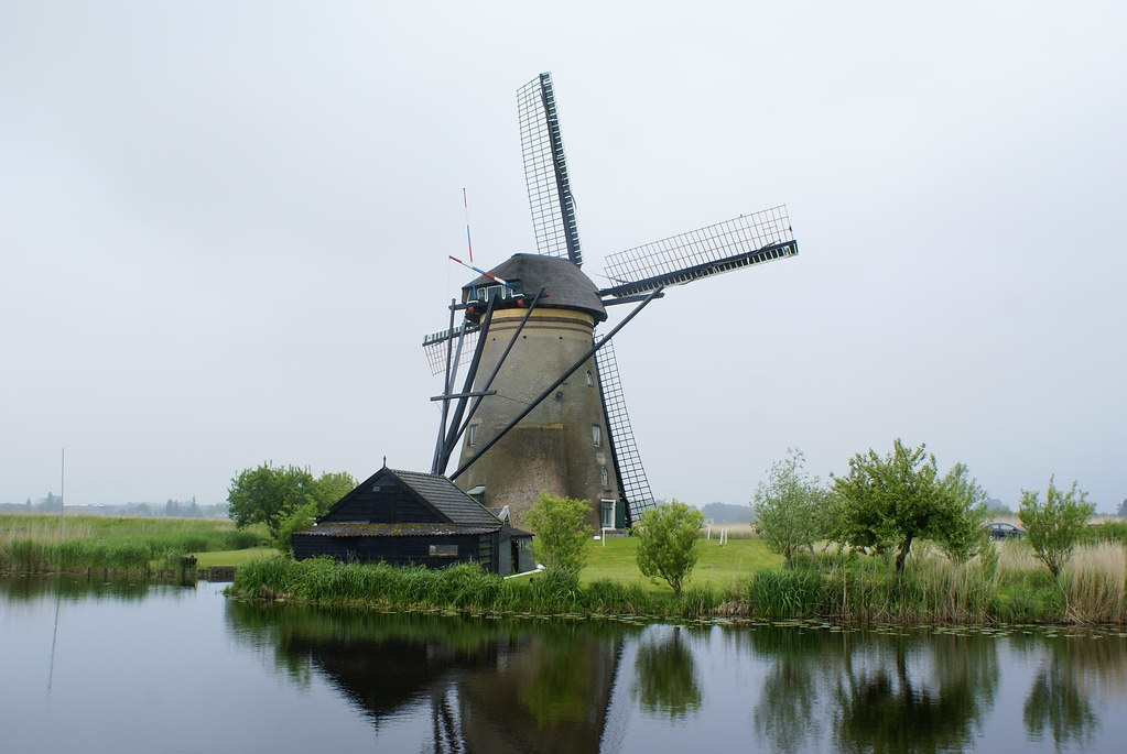 Windmills In Holland The Beautiful Backdrop Of The Dutch