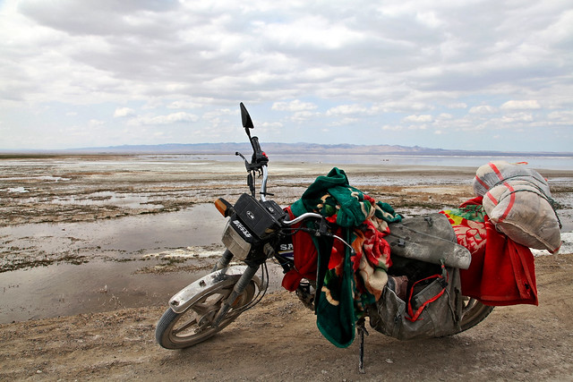 A motorcycle parking on the dirt road, Barkol バルクル、湖畔に停めてあるバイク
