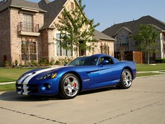 race car(1.0), automobile(1.0), wheel(1.0), vehicle(1.0), performance car(1.0), automotive design(1.0), land vehicle(1.0), muscle car(1.0), srt viper(1.0), supercar(1.0), sports car(1.0),