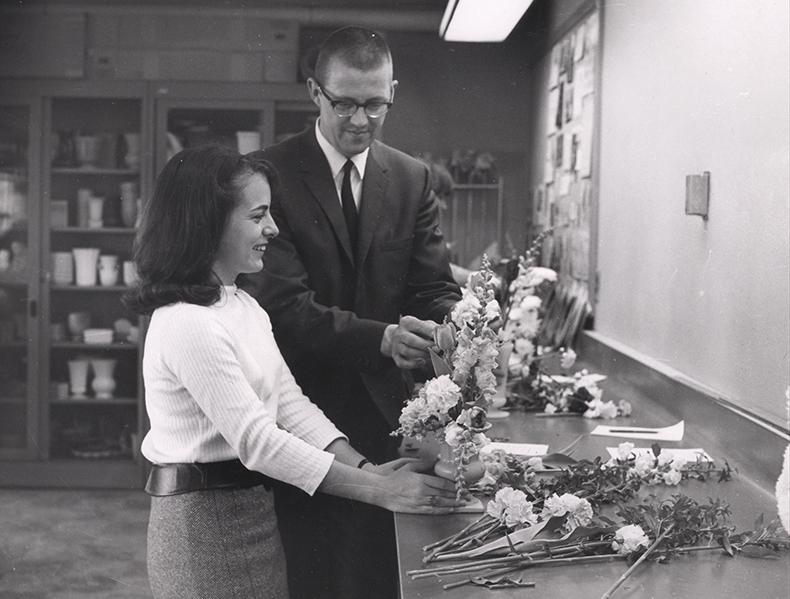 A student learning floral arrangement, late 1950s or early 1960s.