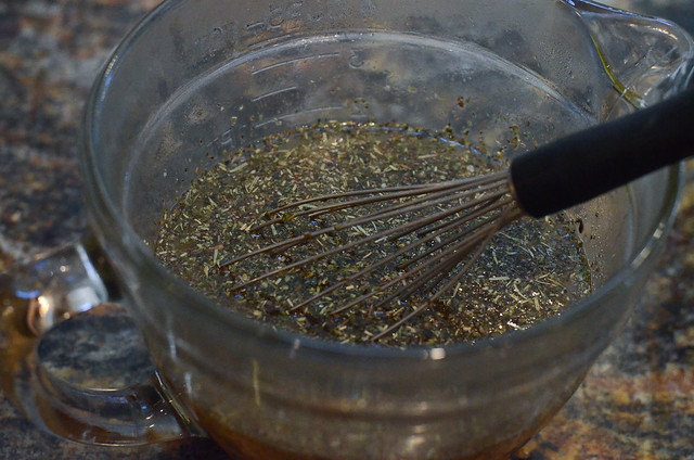Ingredients being whisked together in a glass measuring cup.