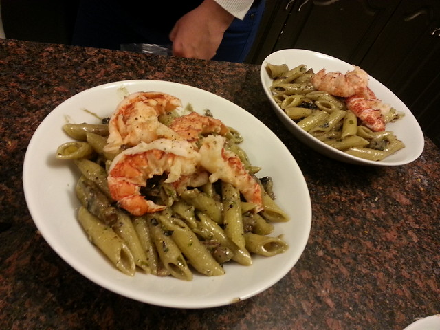 pasta with portobello and pesto cream sauce, topped with lobster tails
