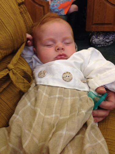 Henry's blessing: Asleep in his wee linen suit