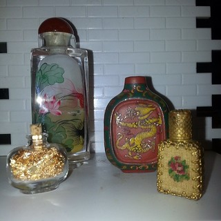 lil bottles Photo credit to @surrender_all_and_come_clean  #perfume #opium #opiate #opiates #antique #antiques #flower #rose #roses #coy #coyfish #dragons #jar #jars #dragon