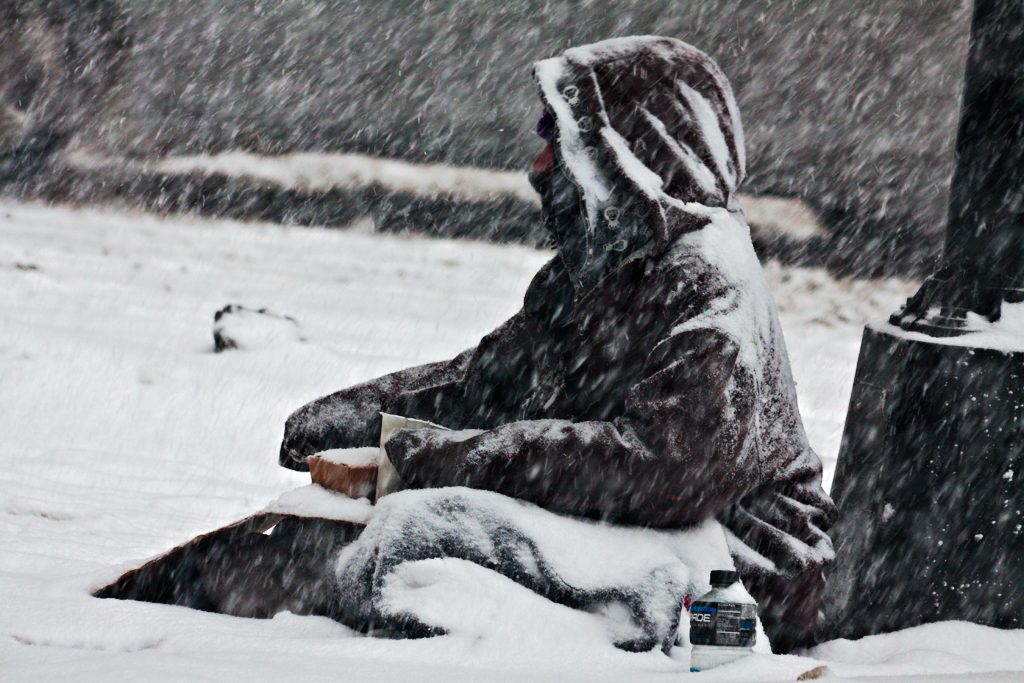 Man-sitting-in-snow,-begging-on-2-17-14--Chicago