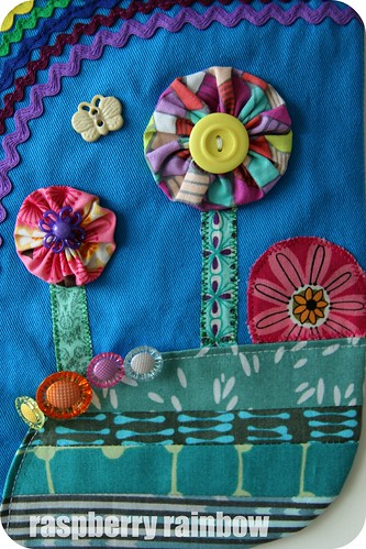 YoYo fabric trees, button flowers, quilted grass.