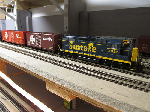 My Santa Fe freight train returns to the rear staging yard at the end of the session.  The Oak Park Society of Model Engineers,H.O Scale Model Railroad Club.  Oak Park Illinois.  October 2013. by Eddie from Chicago