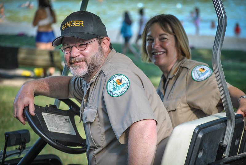 Two Rangers on a golf cart. Photo by Tammy McCorkle