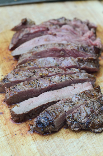 The bison flank steak is sliced into the strips.