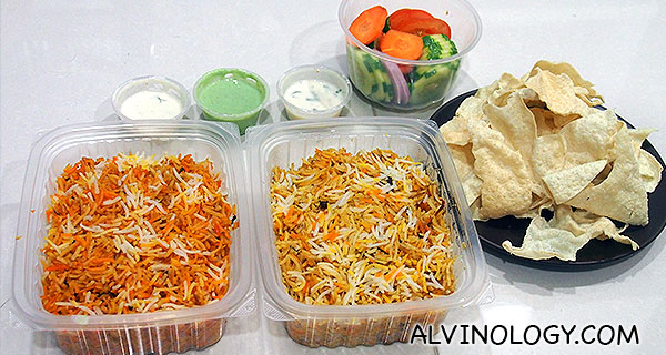 A salad, mutton briyani and chicken briyani to share between two pax