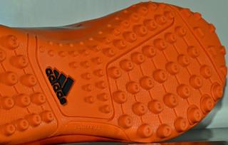 Orange Astroturf trainers