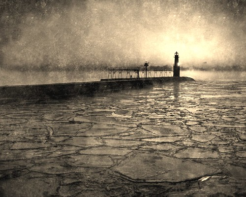 morning light red blackandwhite bw orange sun lighthouse lake reflection texture ice water monochrome silhouette horizontal sepia wisconsin clouds sunrise vintage landscape harbor pier early earlymorning calm lakemichigan wi doorcounty algoma pierlight kewauneecounty billpevlor popsdigital